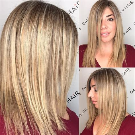 woman hair styles shirt in front longer in back women s blonde highlighted longhair with front layers and