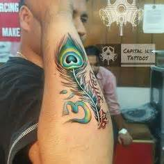 tattoo maker in rajkot kishan name tattoo with flute and peacock feather