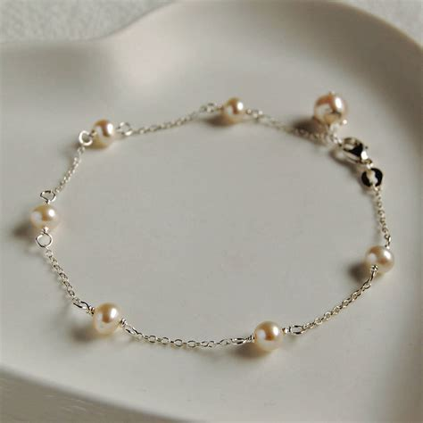 And Bracelet delicate sterling silver and pearl bracelet by highland notonthehighstreet