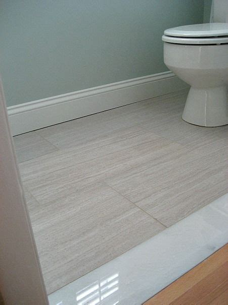 installing floor tiles in bathroom 12x24 florim stratos avorio tile with marble threshold
