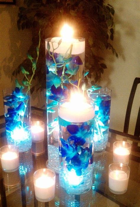 purple water centerpieces blue orchids submerged in vases filled with water and