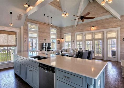 rustic great room  ceiling fan cathedral ceiling