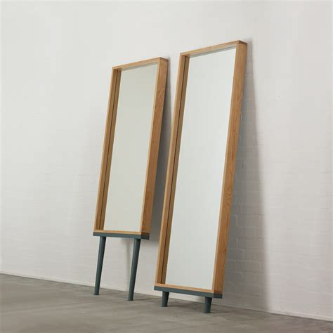modern floor standing mirrors on legs in oak