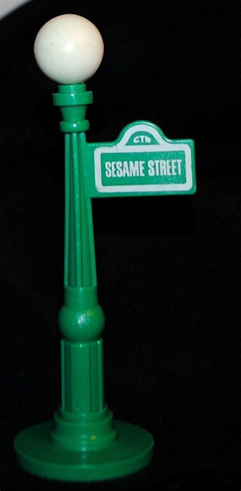 Sesame street sign post dyrevelferdfo fisher price light post and street sign sesame street little aloadofball Image collections