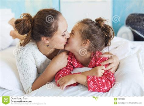 in bed with mom mom with daughter in the bed stock photo image 61017833
