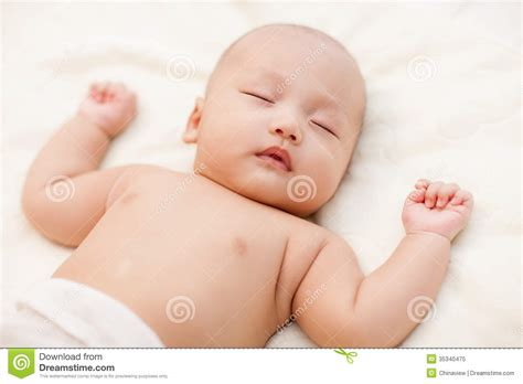 lying on the bed baby lying on bed royalty free stock photo image 35340475