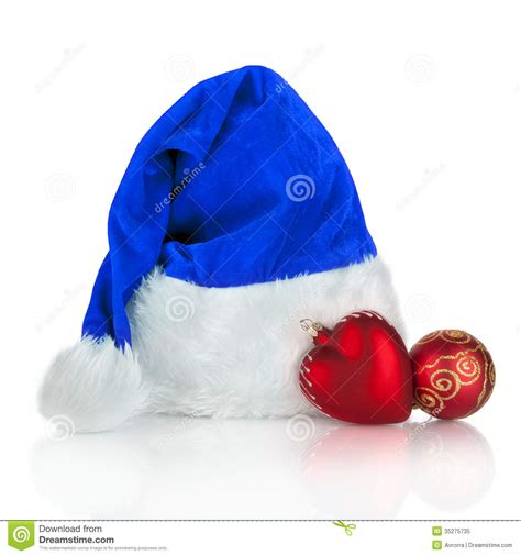 blue santa claus hat and red christmas toy royalty free