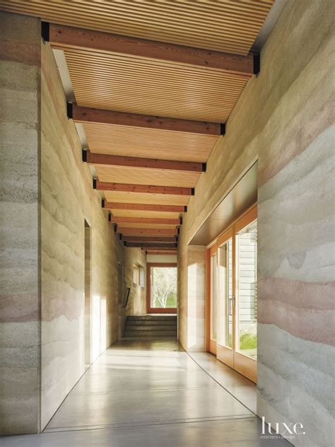 modern neutral hall  slatted ceiling rammed earth
