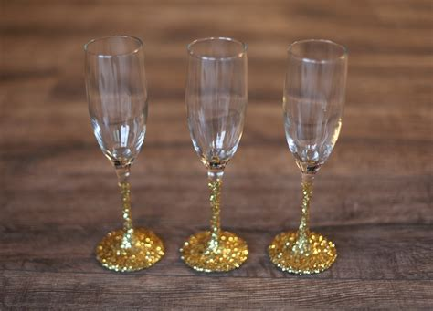 Decorating Glass With Glitter by Host An Enchanting Tree Trimming Chagne Glasses