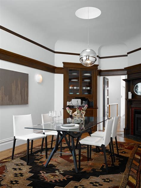 mediterranean living room with dark wood retractable glass white walls dark trim dining room mediterranean with wall