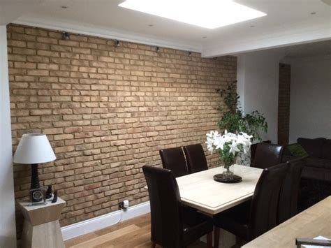dining room feature wall rustic dining room by kuci design ltd