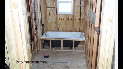 how to put a frame around a bathroom mirror easy bathtub installation tip for new home construction