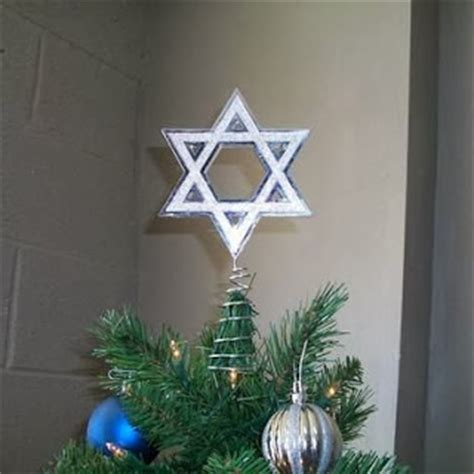 howtoput a star on a christmastree is it okay to put a of david on a tree pqed