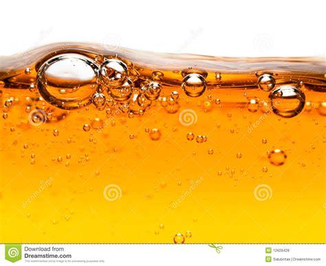Home Plan Designers bubbles in orange liquid soap royalty free stock photos
