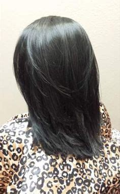 medium length v cut with layers perfect blonde high lights and brown mocha low lights