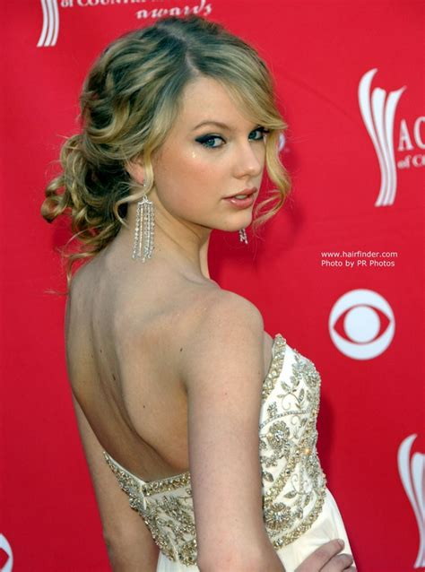 taylor swift updo   loose knot  naturally curly hair