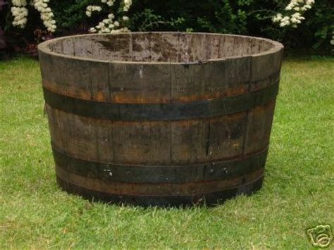 Half Oak Barrel Planter by Half Barrel Planters Look Great With Flowers Or Small