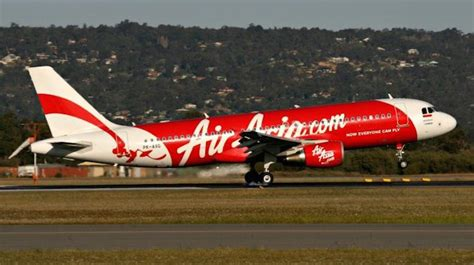 passenger goes psycho on airasia flight to darwin nt news accc says airasia to refund those incorrectly charged