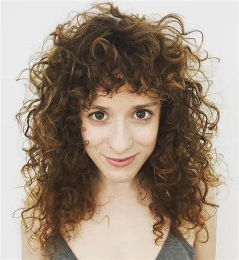 medium hairstyles curly hair with bangs 40 cute styles featuring curly hair with bangs