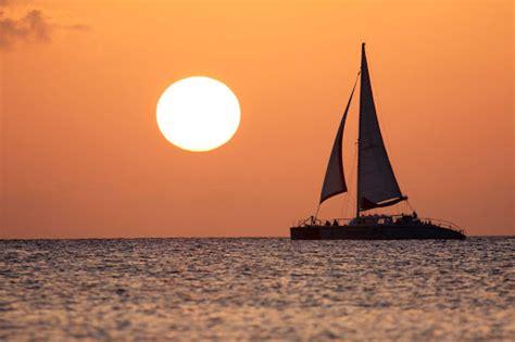 sunset catamaran grand cayman cayman islands cruiseable