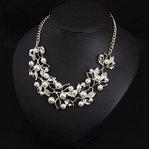 what is jewelry simulated pearl necklace with gold plated leaves