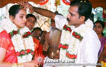 baiju raj ambily wedding photos at sree mahadeva temple