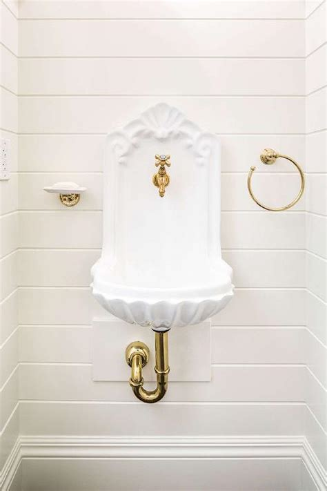 lovely Small Powder Room Decor #2: white-and-gold-powder-room-wall-mount-brass-soap-dish-shiplap-walls.jpg