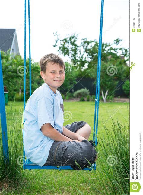 sitting swing teenager sitting on a swing