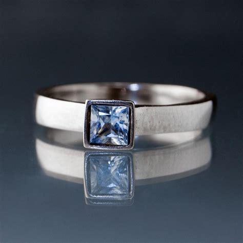light yellow sapphire ring light blue sapphire engagement ring princess cut bezel
