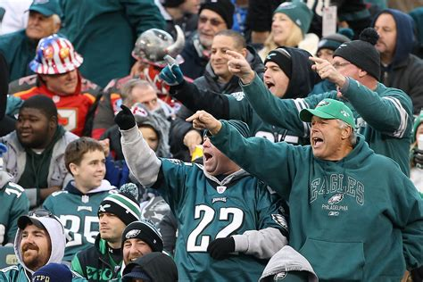 philadelphia eagles fan unruly eagles fans throw bottles and cans at