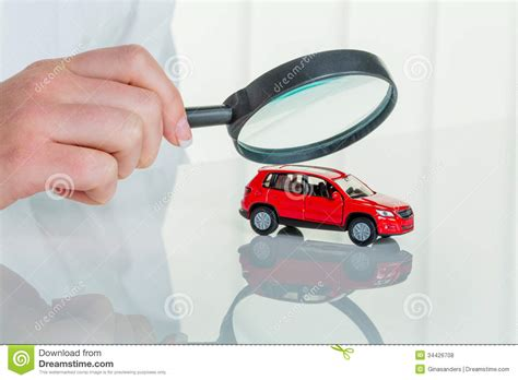Doctors Car Insurance - car is checked by doctor royalty free stock photos image