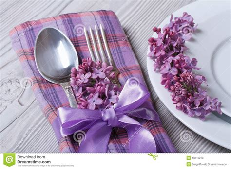 the color purple setting table setting in purple colors decoration flowers lilacs