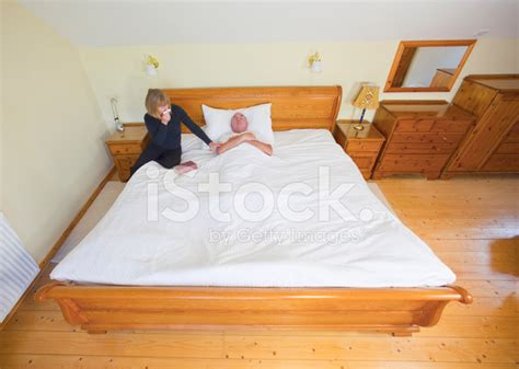 laid on the bed laid out in a large bed stock photos freeimages com