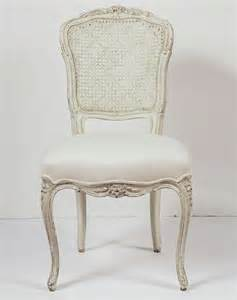 French Country Dining Table - six painted side chairs with cane back at 1stdibs