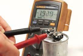 how do i test a capacitor with a multimeter my residential air handler motor seems to be running slower all of a sudden could that be the