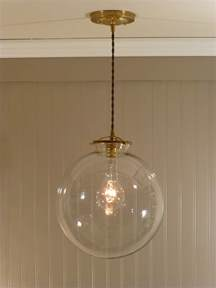 Clear Glass Globe Pendant Light Brass Pendant Light With A 12 Inch Clear Glass Globe 128 00 Via Etsy Home Goods