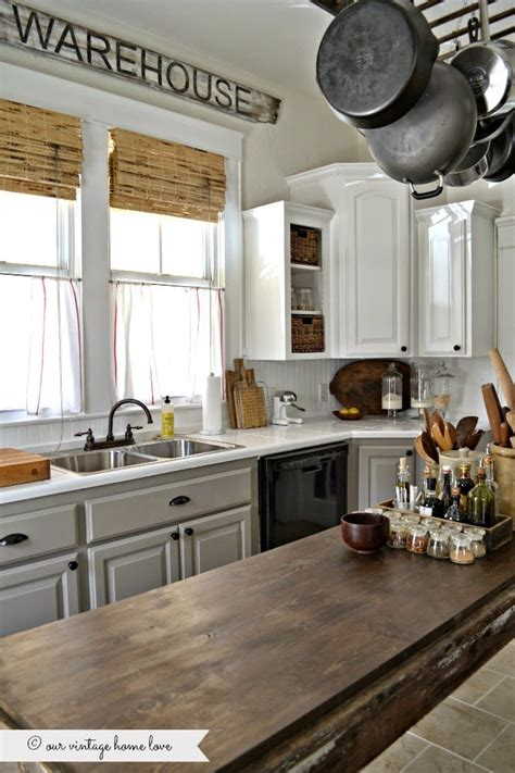 Painted kitchen cabinets white uppers and gray lowers with annie sloan chalk paint in french
