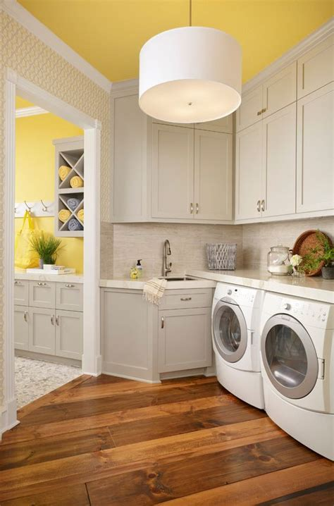 laundry design group bright laundry room wood floor yellow ceiling white