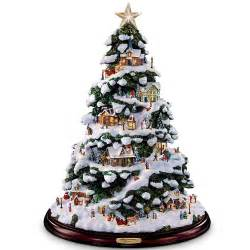 thomas kinkade lighted snow covered christmas tree