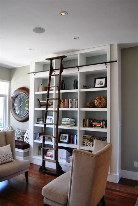 living room with bookshelves library bookcases with ladders tidbits twine