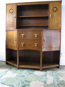 arts and crafts oak dresser with daffodil inlay antiques