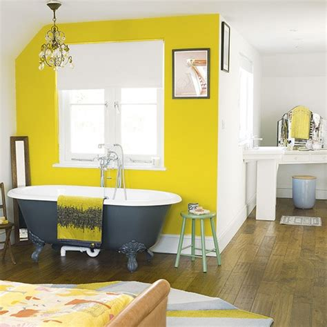 Bedrooms Painted Yellow by Bedroom With Yellow Painted Feature Wall Bedroom Paint