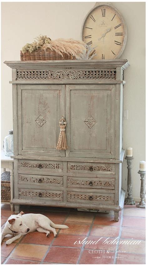 Decorating Ideas For Top Of Armoire by Decorate The Top Of An Armoire