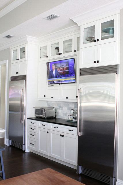 kitchen television ideas tv in kitchen between full size refrigerator and full size
