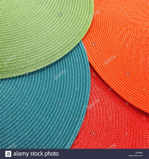 colorful placemats colorful woven placemats overlapping on a table top