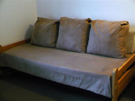 couches that make into beds five large cushions covers and bed cover make bed into