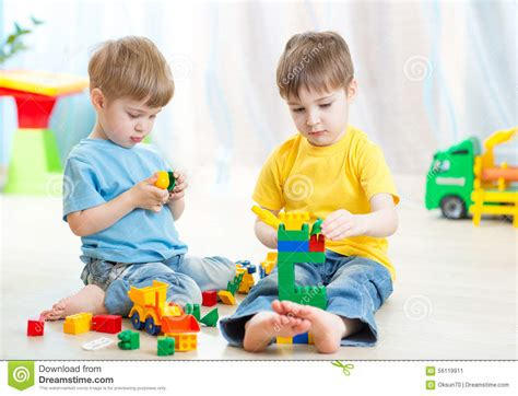 children play toys on floor at home stock image image