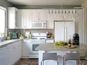 white kitchen cabinets with grey walls linear strand crystal chandelier transitional kitchen