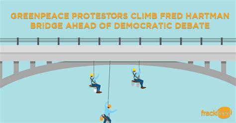 party  science greenpeace activists dangle  bridge