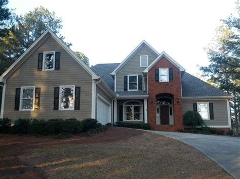 red brick house color schemes tan vinyl siding w white trim and black shutters yard